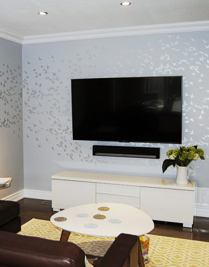 A DIY Stenciled Accent Wall In A Living Room Using The Flock Of Cranes  Birds Wall