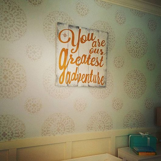 A nursery accent wall that was stenciled with the Antico Allover Stencil from Cutting Edge Stencils. http://www.cuttingedgestencils.com/antico-allover-wall-pattern.html