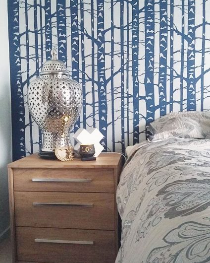A blue and white stenciled bedroom accent wall using the Birch Forest Stencil, a nature inspired wallpaper like pattern, from Cutting Edge Stencils. http://www.cuttingedgestencils.com/allover-stencil-birch-forest.html
