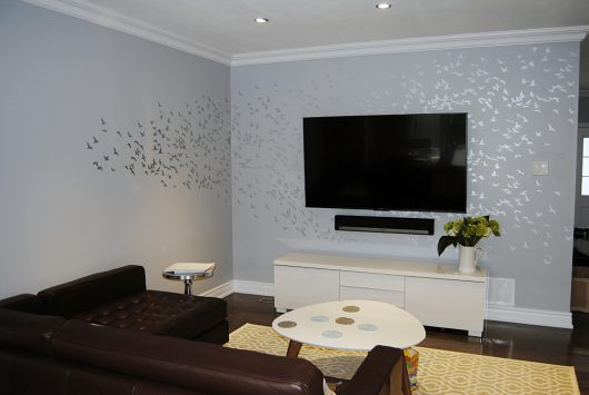 A DIY Stenciled Accent Wall In Living Room Using The Flock Of Cranes Birds
