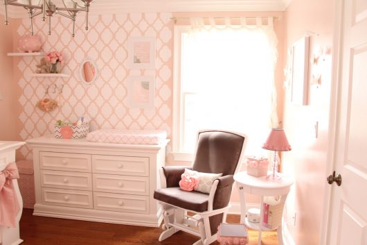 A DIY pink and white stenciled nursery accent wall using the Rabat Allover Stencil, a trendy moroccan wall pattern, from Cutting Edge Stencils. http://www.cuttingedgestencils.com/moroccan-stencil-pattern-3.html