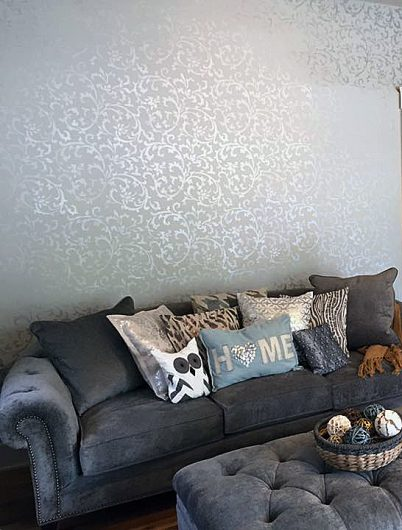 A metallic stenciled living room accent wall using the Victoria Scroll Allover Stencil from Cutting Edge Stencils. http://www.cuttingedgestencils.com/victoria-scroll-wall-pattern-stencil-diy-wall-decor.html