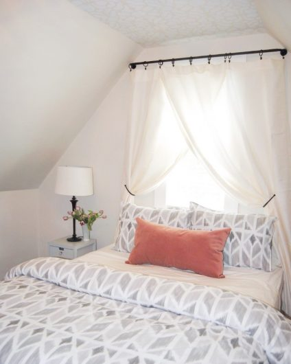 A DIY stenciled white and soft gray ceiling in a guest bedroom using the Vison Allover Stencil, a tribal wall pattern, from Cutting Edge Stencils. http://www.cuttingedgestencils.com/allover-stencil-tribal.html
