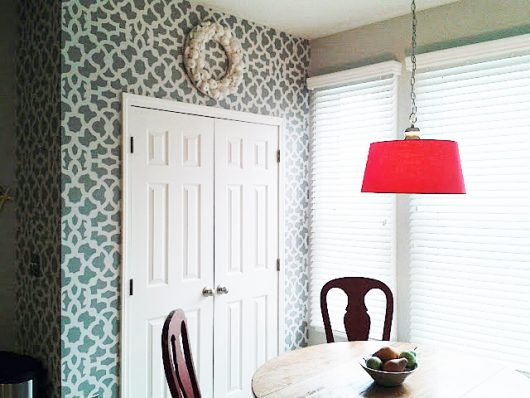 A gray and white stenciled eat in kitchen area using the Zamira Allover Stencil, a popular Moroccan wall pattern, from Cutting Edge Stencils. http://www.cuttingedgestencils.com/moroccan-stencil-designs.html