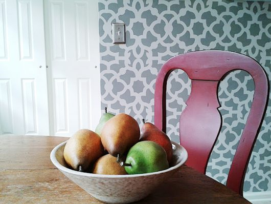 A gray and white stenciled accent wall using the Zamira Allover Stencil, a popular Moroccan wall pattern, from Cutting Edge Stencils. http://www.cuttingedgestencils.com/moroccan-stencil-designs.html