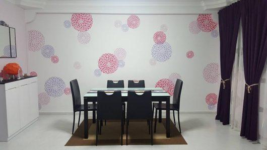 A DIY stenciled dining room accent wall using the three piece Zinnia Grande Stencil, popular flower stencils, from Cutting Edge Stencils. http://www.cuttingedgestencils.com/zinnia-grande-stencil-kit.html