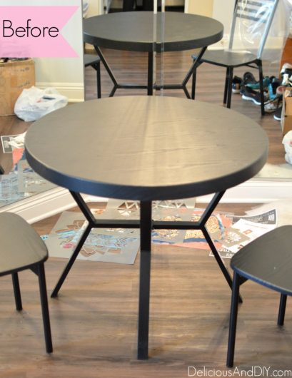 A small black dining table before its stenciled makeover. http://www.cuttingedgestencils.com/patchwork-tile-pattern-stencil-wall-tiles.html