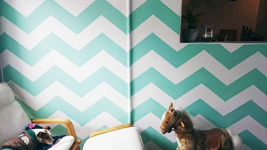 A stenciled playroom accent wall using the Chevron Allover Stencil from Cutting Edge Stencils. http://www.cuttingedgestencils.com/chevron-stencil-pattern.html