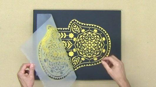 Learn how to stencil on canvas using the Hamsa Hand, a Mandala stencil pattern, from Cutting Edge Stencils. http://www.cuttingedgestencils.com/hamsa-hand-mandala-stencil.html