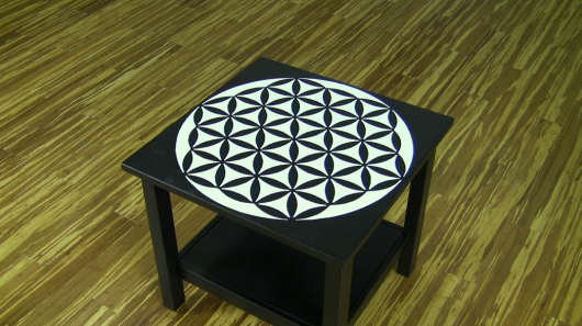 A DIY stenciled small table using the Flower of Life Mandala Stencil from Cutting Edge Stencils. http://www.cuttingedgestencils.com/flower-of-life-mandala-stencil-yoga-design.html