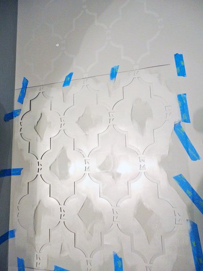 Stenciling an accent wall with the Marrakech Trellis Stencil, a Moroccan wall pattern, from Cutting Edge Stencils. http://www.cuttingedgestencils.com/moroccan-stencil-marrakech.html