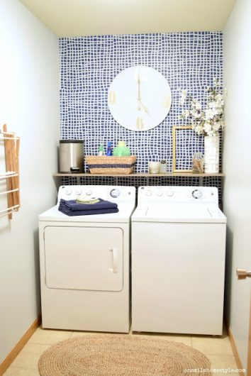 A DIY stenciled accent wall in a laundry room using the Mesh Allover Stencil, a popular geometric grid wall pattern, from Cutting Edge Stencils in Glidden Rich Navy and Silvery Moonlight. http://www.cuttingedgestencils.com/mesh-contemporary-stencil-grid-pattern.html
