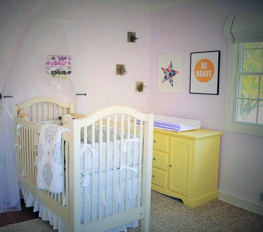 A purple and white stenciled nursery accent wall using the Rabat Allover Stencil, a trendy Moroccan wall pattern, from Cutting Edge Stencils. http://www.cuttingedgestencils.com/moroccan-stencil-pattern-3.html