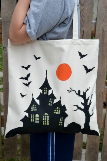 A DIY stenciled tote bag using the Haunted House Stencil from Cutting Edge Stencils. http://www.cuttingedgestencils.com/haunted-house-tote-stencil-halloween-accent-pillow-stencils.html