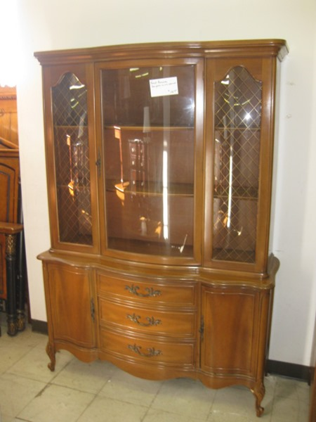 A brown wooden hutch before its stenciled makeover. http://www.cuttingedgestencils.com/beads-craft-stencils-DIY-home-decor.html