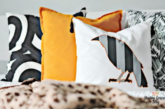 A DIY stenciled Halloween accent pillow using the Crow Stencil from Cutting Edge Stencils. http://www.cuttingedgestencils.com/crow-stencil-design-halloween-home-decor-diy-pillow-kit.html