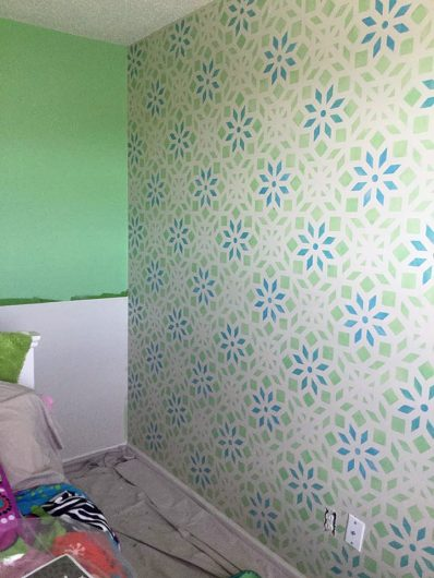 Stenciling a blue and green accent wall in a girls bedroom using the Kerala Allover Stencil from Cutting Edge Stencils. http://www.cuttingedgestencils.com/kerala-indian-stencil-geometric-pattern-stencils.html