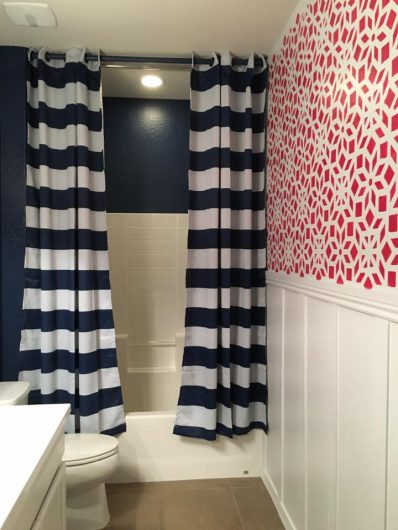 A red and white stenciled accent wall in a bathroom using the Kerala Allover Stencl from Cutting Edge Stencils. http://www.cuttingedgestencils.com/kerala-indian-stencil-geometric-pattern-stencils.html