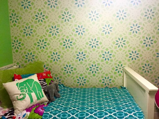 A blue and green DIY stenciled accent wall in a girls bedroom using the Kerala Allover Stencil from Cutting Edge Stencils. http://www.cuttingedgestencils.com/kerala-indian-stencil-geometric-pattern-stencils.html