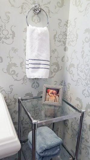 A DIY gray stenciled guest bathroom using the Oceana Damask Stencil from Cutting Edge Stencils. http://www.cuttingedgestencils.com/stencil-nautical-decor.html