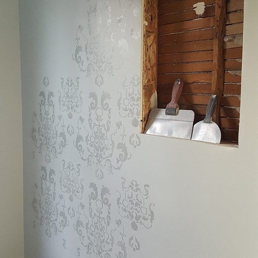 Stenciling a DIY gray stenciled guest bathroom using the Oceana Damask Stencil from Cutting Edge Stencils. http://www.cuttingedgestencils.com/stencil-nautical-decor.html