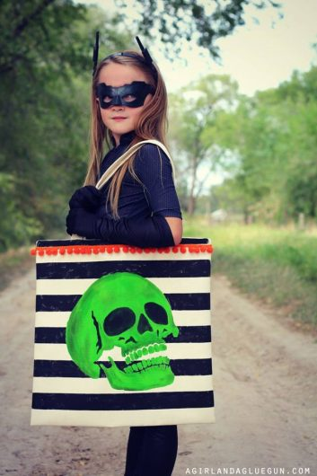A DIY stenciled trick or treat bag for Halloween using the Skull Stencil from Cutting Edge Stencils. http://www.cuttingedgestencils.com/skull-stencil-diy-halloween-decor-trick-or-treat-tote.html