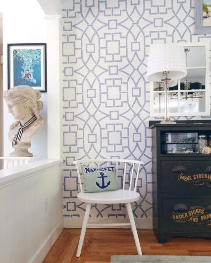 A blue and white stenciled accent wall using the Tea House Trellis, a geometric wall pattern, from Cutting Edge Stencils. http://www.cuttingedgestencils.com/tea-house-trellis-allover-stencil-pattern.html