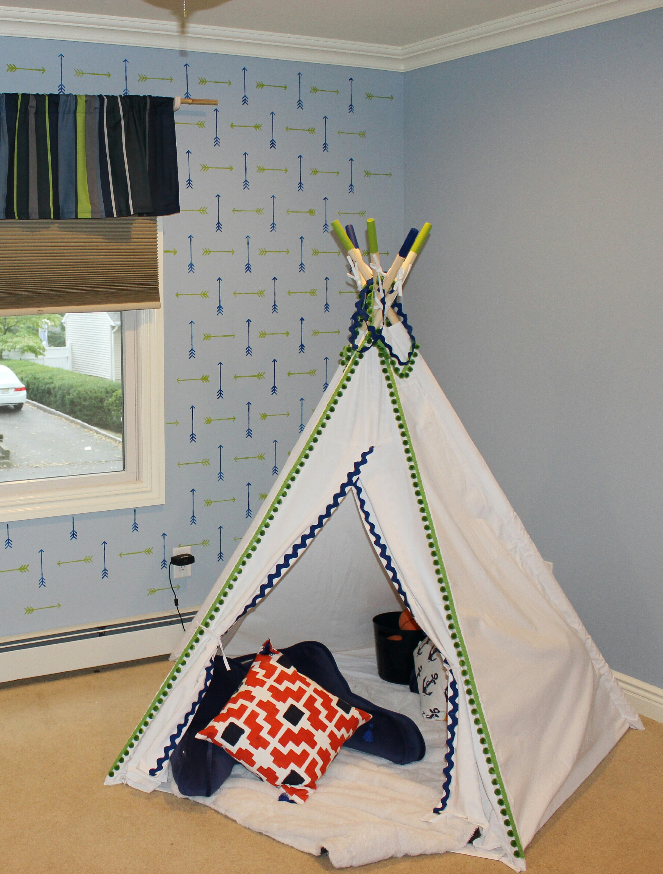before and after an arrow stenciled boys bedroom stencil stories a white canvas teepee in a tribal stenciled boys bedroom using the tribal arrows allover