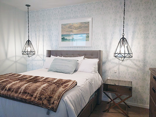 A DIY stenciled bedroom accent wall using the Ikat Bukhara Allover Stencil from Cutting Edge Stencils. http://www.cuttingedgestencils.com/stencil-ikat-damask.html