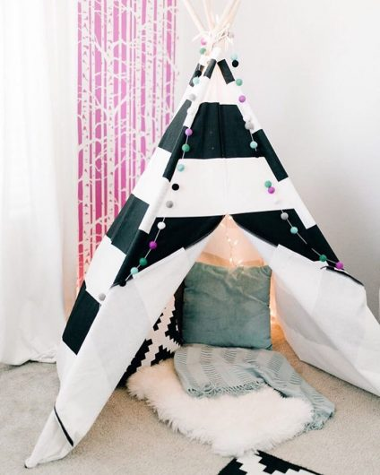 A pink and white playroom accent wall behind a teepee using the Birch Forest Allover Stencil from Cutting Edge Stencils. http://www.cuttingedgestencils.com/allover-stencil-birch-forest.html