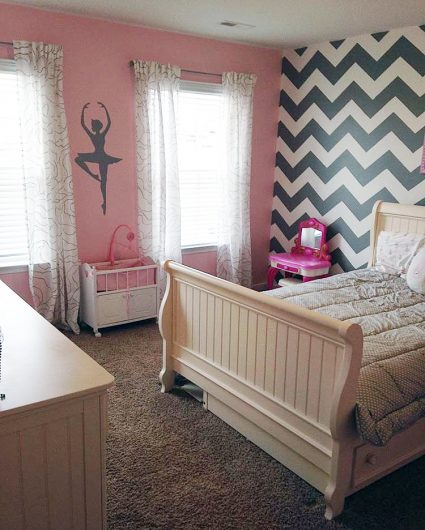 A DIY gray, white, and pink stenciled girl's bedroom accent wall using the Chevron allover Stencil from Cutting Edge Stencils. http://www.cuttingedgestencils.com/chevron-stencil-pattern.html