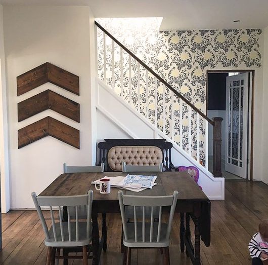 A stenciled stairway has a wallpaper look using the Julia Allover Stencil from Cutting Edge Stencils. http://www.cuttingedgestencils.com/julia-wall-stencil.html