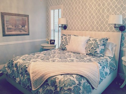 A gray and white stenciled bedroom accent wall using the Rabat Allover Stencil from Cutting Edge Stencils. http://www.cuttingedgestencils.com/moroccan-stencil-pattern-3.html