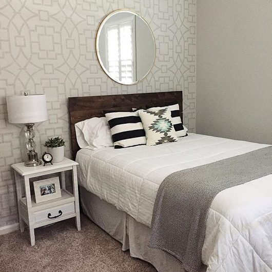 A stenciled living room accent wall in gray and white using the Tea House Trellis Stencil, an oversized geometric wall pattern, from Cutting Edge Stencils. http://www.cuttingedgestencils.com/tea-house-trellis-allover-stencil-pattern.html