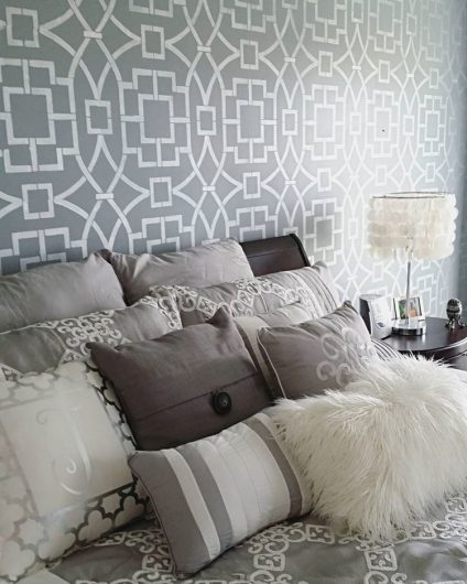 A DIY gray and white stenciled bedroom accent wall using the Tea House Trellis Stencil from Cutting Edge Stencils. http://www.cuttingedgestencils.com/tea-house-trellis-allover-stencil-pattern.html