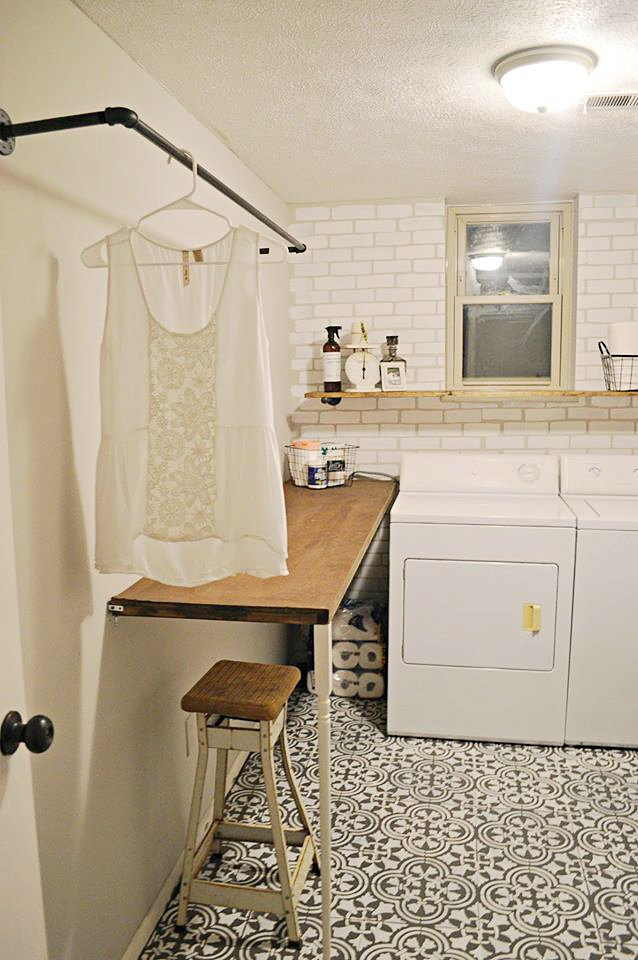 A DIY stenciled laundry room accent wall achieves a subway tile look using the Brick Allover Stencil from Cutting Edge Stencils. http://www.cuttingedgestencils.com/bricks-stencil-allover-pattern-stencils.html