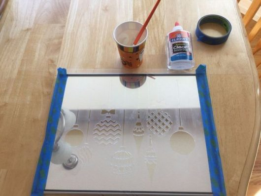 Learn how to stencil a mirror with glitter and the Christmas Ornaments Craft Stencil from Cutting Edge Stencils. http://www.cuttingedgestencils.com/diy-christmas-decor-craft-and-furniture-stencils.html