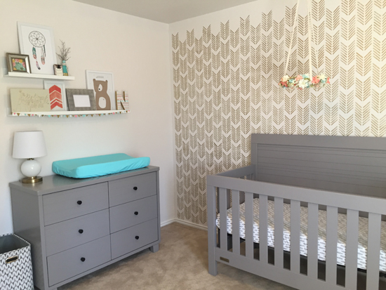 A DIY gold and off white, tribal bohemian themed stenciled girl's nursery using the Drifting Arrows Allover Stencil from Cutting Edge Stencils. http://www.cuttingedgestencils.com/drifting-arrows-stencil-pattern-diy-decor.html