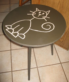 A small black table before its stenciled makeover. http://www.cuttingedgestencils.com/prosperity-mandala-stencil-yoga-mandala-stencils-designs.html