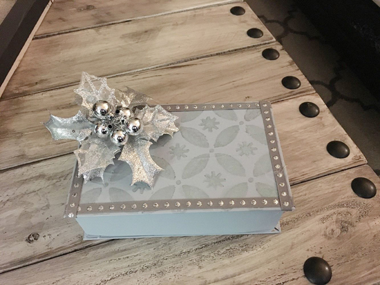 A DIY stenciled holiday gift box using the Holiday Cheer Craft Stencil from Cutting Edge Stencils. http://www.cuttingedgestencils.com/christmas-stencils-designs-holiday-cheer.html