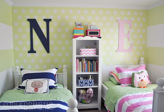 A DIY shared girl boy bedroom that has a stenciled accent wall using the Polka Dot Allover Stencil from Cutting Edge Stencils. http://www.cuttingedgestencils.com/polka-dots-stencils-nursery.html