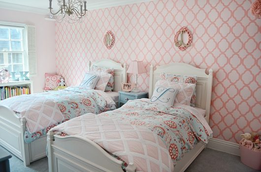 A pink and white shared girls bedroom using the Rabat Allover Stencil, a popular Moroccan wall pattern, from Cutting Edge Stencils. http://www.cuttingedgestencils.com/moroccan-stencil-pattern-3.html