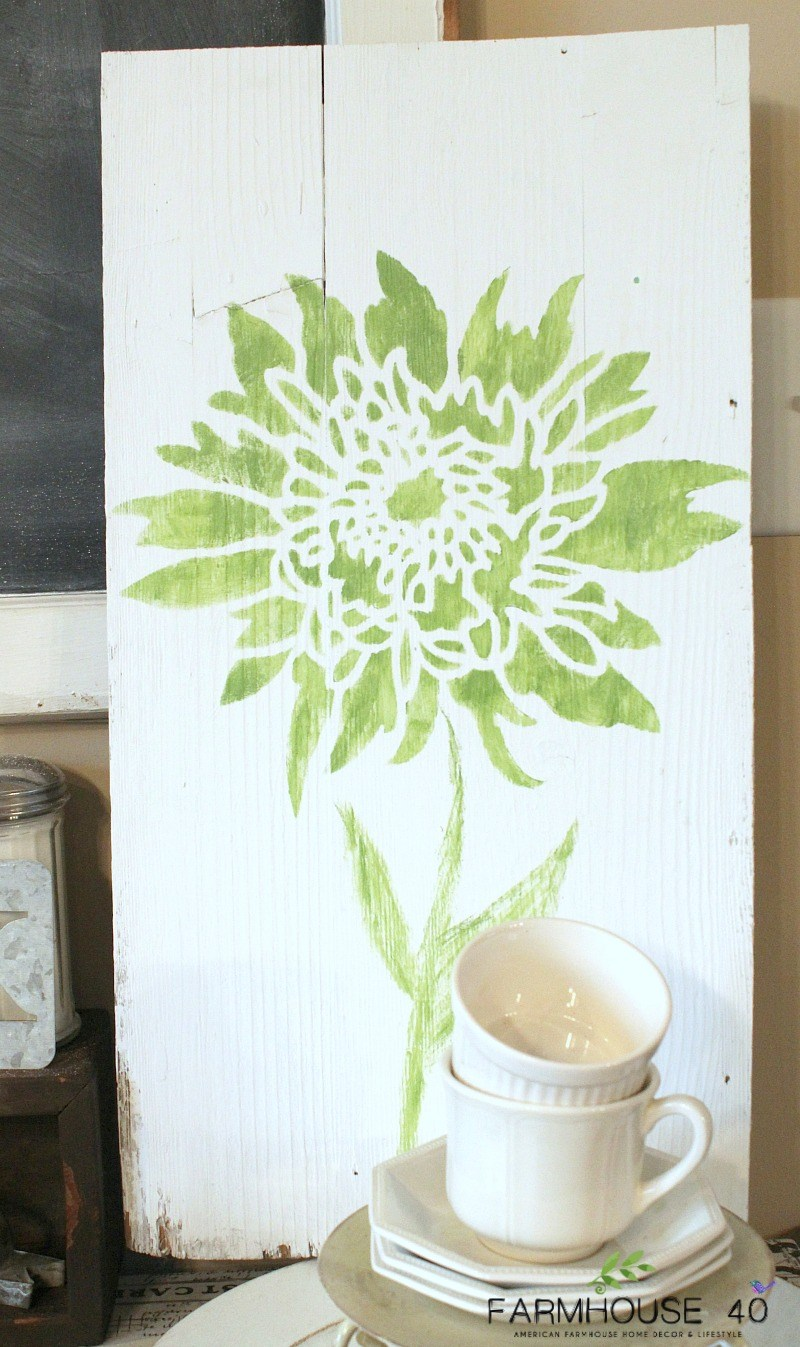 DIY stenciled wall art using wood and the Chrysanthemum Grande Flower Stencil from Cutting Edge Stencils. http://www.cuttingedgestencils.com/flower-stencil-4.html