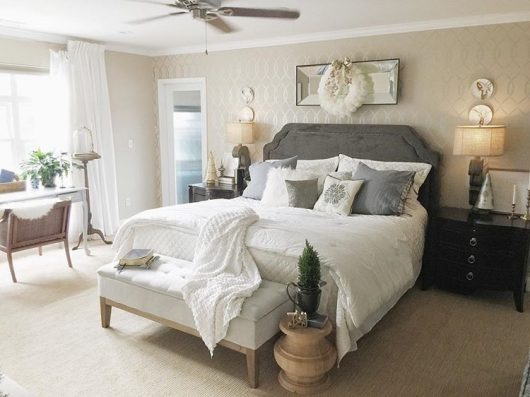 A neutral colored bedroom with a metallic silver stenciled accent wall using the Entwined Allover Stencil from Cutting Edge Stencils. http://www.cuttingedgestencils.com/stencil-pattern-2.html