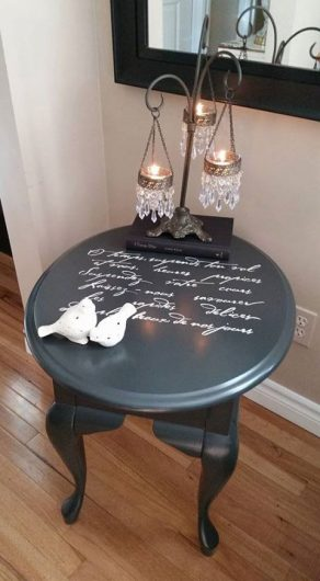 A DIY stenciled black table that was painted with the French Poem Craft Stencil from Cutting Edge Stencils. http://www.cuttingedgestencils.com/french-poem-diy-craft-stencil-design.html