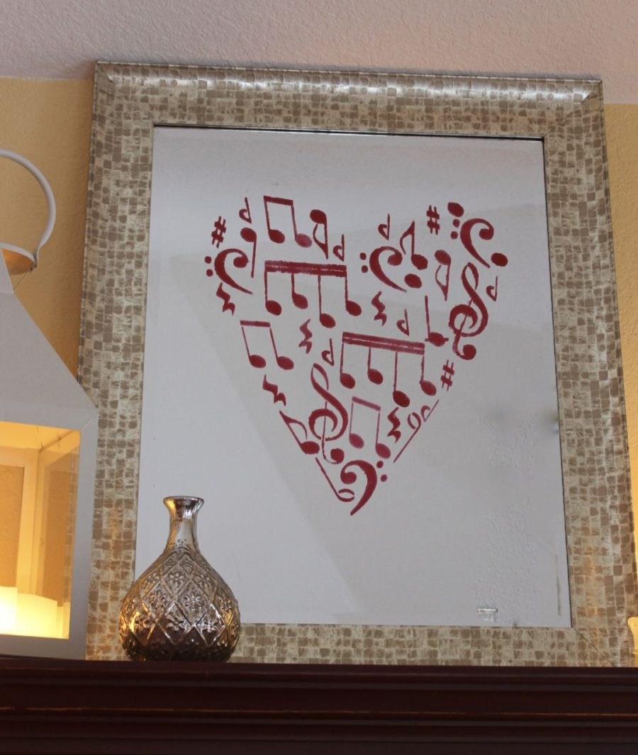 A DIY stenciled mirror for Valentine's Day using the Musical Notes Allover Stencil from Cutting Edge Stencils in heart shape. http://www.cuttingedgestencils.com/musical-notes-stencil-wall-design.html