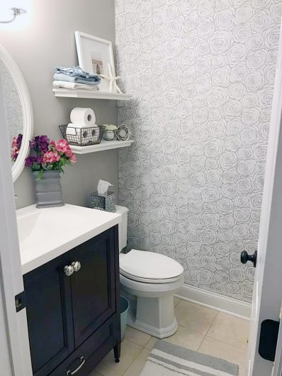 A DIY stenciled bathroom accent wall using the Roses Allover Stencil from Cutting Edge Stencils. http://www.cuttingedgestencils.com/roses-stencil-pattern-rose-design.html