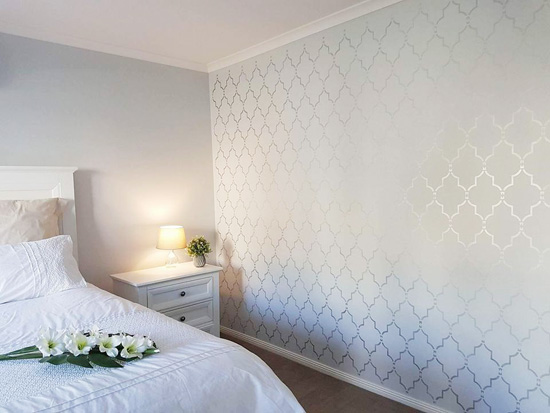 A metallic stenciled bedroom accent wall using the Marrakech Trellis Allover Stencil from Cutting Edge Stencils. http://www.cuttingedgestencils.com/moroccan-stencil-marrakech.html