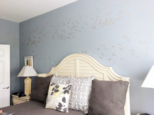 A DIY blue and beige stenciled bedroom accent wall using the Flock of Cranes Allover Stencil from Cutting Edge Stencils. http://www.cuttingedgestencils.com/bird-flock-wall-stencil-pattern.html