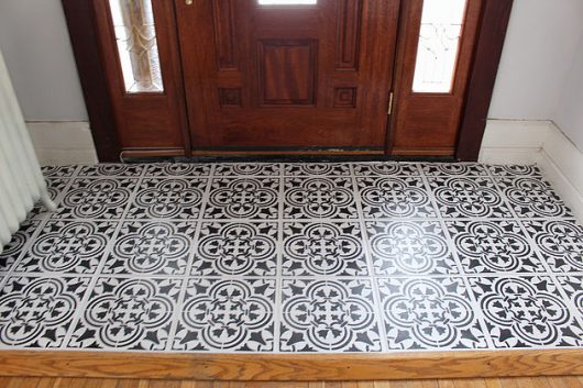 A DIY stenciled entryway floor using the Augusta Tile Stencil from Cutting Edge Stencils. http://www.cuttingedgestencils.com/augusta-tile-stencil-design-patchwork-tiles-stencils.html